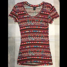 Rue 21 Tribal Print Tee Very cute tribal tee - coral, purple, blue, white, black, and peach pattern. Stretchy - 95% rayon 5% spandex. Great condition! Rue 21 Tops Tees - Short Sleeve