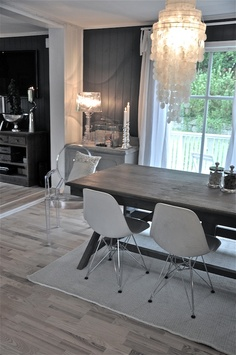 Neutral grey, black, and white color scheme in painted wood paneled room. This is one way to update wood panelling. Lots of white trim. But love the grey walls.