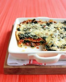 Spinach-rich, vegetarian mexican lasagna.    Next time, I'll dry the spinach a bit better and use a thicker brand of salsa. (I like Herdez salsa, but it is kinda watery.)    I blended a jalapeno in with the spinach and it added a nice element. I used mozarella I had on hand instead of pepper jack.