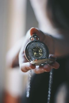 silver pocket watch, soft focus, shallow depth of field. Me & Orla.