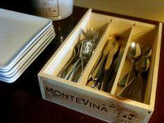 Repurposed wine box for tableware.