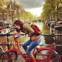Mo with her red Mochita and matching red bicycle in Amsterdam, Netherlands, Holland