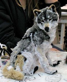 """3.) An arctic wolf made only using pipe cleaners. i can just see the person who made it saying """"well, it was more fun than a puzzle last time we were snowed in..."""""""