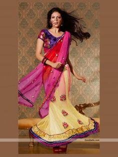 Designer pattern lehenga saree embellished with blend of pink, red and cream shades. Fish cut lehenga looks stylish with dual shade pallu. Embroidered patch work enhances its beauty. Perfect selection for bridal. http://goodbells.com/saree/multicolor-lehenga-pattern-designer-saree.html