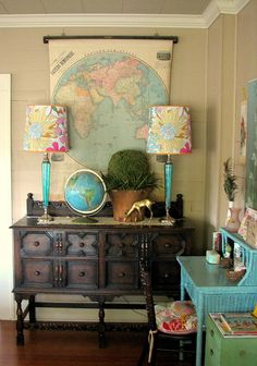 Love this combination of dark/antiques and turquoise, pinks, greens...love the map!  Very fun space.