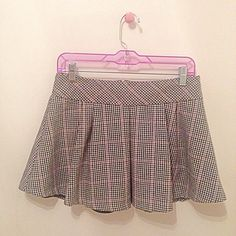 "Pleated Mini Skirt Colors: pink, black, white Hidden zipper down in back  Shell: Wool & Polyester; Lining: Polyester Dry Clean Only  ✂️APPROX MEASUREMENTS:  L: 14""  W: 13""  ❌No Trades, No PP❌ Offer Button Only GUC ✅Bundle Friendly!✅ Express Skirts"
