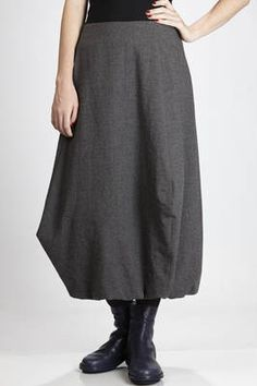 Yukai | long skirt in wool, linen, polyamide and cotton crêpe | long skirt in wool, linen, polyamide and cotton crêpe, posterior zipper fastener, flared line with the bottom that has a tulip effect and elastic band on the inner side that creates a curling effect, lined | article code: 25305 | season: Autumn/Winter | composition: 45% wool - 43% flax - 11% polyamide - 1% cotton