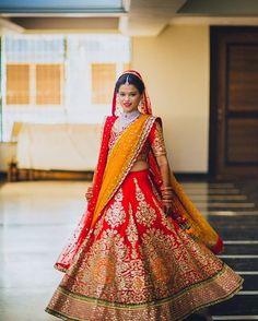 Ravishing in red. We loved Shradha's vibrant red lehenga complimented with an orange dupatta for her pheras. Photo Courtesy- @NishithDayalPhotography (Mumbai) #redandorange #lehengalookbook #bridaljewellery #candidshot #bride #indianbride #wedding #indianwedding #weddingsutra #bridallook #dday #bridalshoot #traditional #indianwedding #WeddingSutra #redlehenga #gotapatti #bridegettingready #candidphotography #lehengadiaries #desibride #redlehenga #royallehenga #ravishing