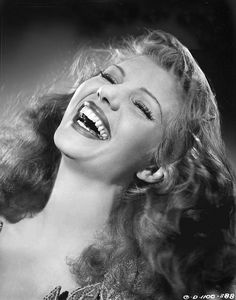 Rita Hayworth lovely like that she is laughing!