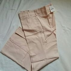 J. Crew pants Pale pink 100% cotton Chino low fit pants. Sits just above hip and fitted through the hip. Flare to wider leg. Flap back pockets. Two front pockets. Double clasp plus button and zip closure. J. Crew Pants Trousers