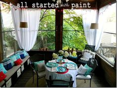 Screen porch with a blue, turquoise, red, and white color scheme. ItAllStartedWithPaint.com #porch