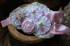 Yo Yo fabric flower ideas. Sweet tea party,vintage inspired headband,fascinator,cottage chic,yoyo flowers.pink and ivory,over the top,photo prop. $18.00, via Etsy.
