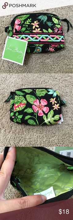 NWT Vera Bradley Small Cosmetic bag NWT Vera Bradley small cosmetic bag in Botanica. Lined inside for spills and smudges makeup leaves. Zipper at the top. Vera Bradley Makeup