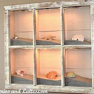 Beach Shadow Box (Source Unknown) old window frame + sand + shells and other accents + lights You can find lots of window frames at Habitat for Humanity for really cheap. Seashell Crafts, Beach Crafts, Seashell Projects, Crafts With Seashells, Seashell Ornaments, Snowman Ornaments, Beach House Decor, Diy Home Decor, Beach House Furniture