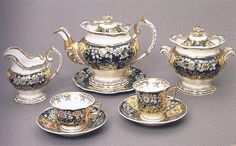 In England, matching porcelain tea sets were produced from the 1760s. With the invention of bone-china in about 1800, production of inexpensive but extravagantly decorated tea services expanded rapidly. Here, the teapot and milk jug closely imitate contemporary silver, while the cup shapes display the increasing ornateness that accompanied the rococo revival of the 1820s.