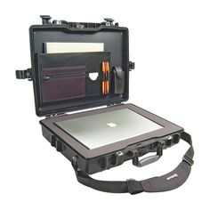 Hard, watertight, crush-proof, and dust-proof case made to carry a laptop computer.