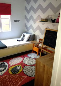 Awesome rug and Grey chevron wall in Matilda's room