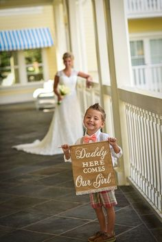 "Cutest ring bearer carrying a ""Daddy here comes our girl"" banner at a Disney's Fairy Tale Wedding"
