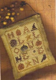 """""""Bits of Halloween"""" is the title of this cross stitch pattern from Homespun Elegance."""