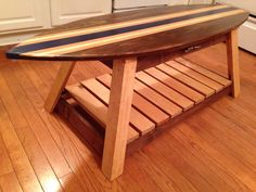 Amazing Surfboard Coffee Table with Interchangeable Top by dragonflydesignsbykb on Etsy https://www.etsy.com/listing/168766388/amazing-surfboard-coffee-table-with