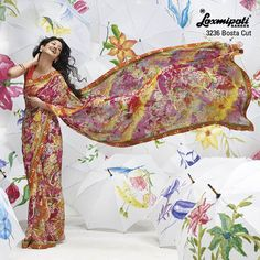 Bunches of flower are fragrant on this hot multi color brasso saree... makes more lively & natural.