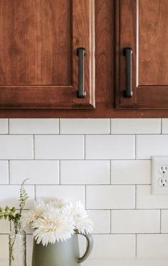 A kitchen remodel with wood cabinets and white countertops. This DIY kitchen mak. - A kitchen remodel with wood cabinets and white countertops. This DIY kitchen makeover on a budget h - Budget Kitchen Remodel, Kitchen On A Budget, Kitchen Ideas, Kitchen Decor, Kitchen Makeovers, Bathroom Makeovers, Rustic Kitchen, Kitchen Trends, Kitchen Inspiration