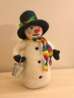 Christmas needlefelted snowman with a bucket