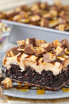 This Snickers Poke Cake is so darn good. Chocolate cake soaked with a caramel + milk mixture, then topped with peanut butter whipped cream + Snickers bits! Poke Cake Recipes, Poke Cakes, Cupcake Cakes, Dessert Recipes, Cupcakes, Easy Desserts, Unique Desserts, Dessert Bars, Cookie Recipes
