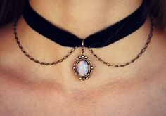 This unique 90s choker is perfect for dressing up or down. it is made with velvet ribbon, antique brass chain, and a glass pink fire opal cabochon in an antique brass setting. The necklace is 12 inches long and has a 3 inch extender. If your need smaller than 12 inches or larger than 15 inches please feel free to contact me. See what other unique pieces I have in my shop: www.etsy.com/shop/alapopjewelry Sending this as a gift? let them know who is sending it with a free gift tag with a…