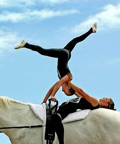 Two people vaulting
