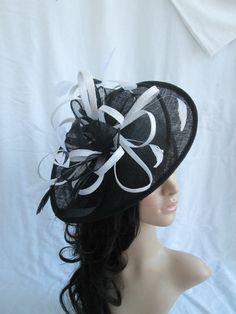 Black Fascinator....Stunning  Black & White Sinamay Fascinator Hat on a Headband #design #motherofbride