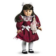 Cranberry Party Dress  Samantha's Christmas outfit of cranberry taffeta is the perfect Victorian party dress. It's tied with a white satin sash and trimmed with beautiful lace and elegant ruffles. A pair of white stockings and a wide satin hair ribbon finish this Christmas confection.  $22 SCO