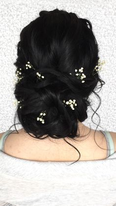 Loose updo with baby's breath on black brunette hair
