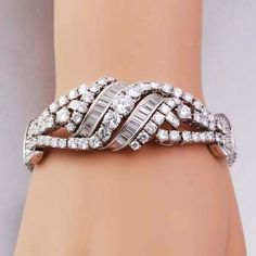 Antique Art Deco 35.00cts Platinum Baguette & Round Diamond Bracelet  This stunning antique Art Deco bracelet is hand made of solid platinum! The piece is lavishly set with about 133 round Brilliant cut excellent top quality diamonds and 44 baguette cut diamonds, approx. 35.00.00 cttw, G color, VS1 clarity. The bracelet exposes a fine hidden clasp and bears gorgeous brilliancy!Length approx. 6 3/4