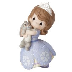 Dressed like her favorite village girl turned princess - this sweet girl wears a pretty purple gown inspired by Disney's Sofia the First. She offers a cuddly hug to her fluffy bunny, Clover, to show h