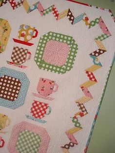 Very fun quilt with a unique setting.    From http://www.aquiltinglife.com/2011/05/vintage-dishes.html