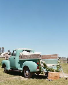 Danette Burr of Style Jackson Hole spruced up this vintage pickup truck using plants and pillows plus a carving of the couple's initials. The bride and groom took the ride from the ceremony to the reception tent. Vintage Pickup Trucks, Jackson Hole Wyoming, Eclectic Wedding, Groom And Groomsmen Attire, Countryside Wedding, Outdoor Venues, Martha Stewart Weddings, Once In A Lifetime, Florida Travel