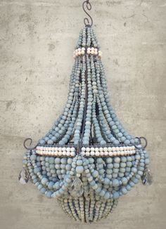 Two tone (blue and white) ceramic beaded chandeliers, made by HIV positive women in South Africa, proceeds go to an excellent cause