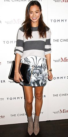 JAMIE CHUNG Not since 50 Shades has gray gotten us so excited. Jamie keeps the color, which has a bad rap for being blah, interesting by mixing prints: a floral Cameo mini with a striped sweater, metallic-embellished booties and an oversize patent clutch.