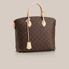 Lockit MM Monogram Canvas Classic Monogram canvas is beautifully matched with an iconic house design in the shapely form of the Lockit MM. Its elegance is enhanced by the alluring burgundy goat lining that adorns its interior.