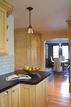 """Kitchen remodel in Portland, OR.  Small, unusable breakfast nook was incorporated into larger kitchen space. Side wall was pushed out 30"""". Small opening to dining room was widened and received a 'gothic archway' treatment matching some of the existing archways elsewhere in the house."""