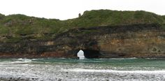 The Hole in the Wall is a rocky archway set just off the Wild Coast, south of Coffee Bay in the Eastern Cape.