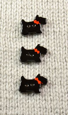 Handpainted ceramic scotty dog buttons, x3 by DebraRutherford on Etsy https://www.etsy.com/listing/104477228/handpainted-ceramic-scotty-dog-buttons