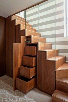 Under stairs storage spaces.