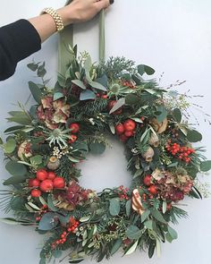 christmas wreaths Chalky grey greens with pops of red for lovely matildagoad Theres still time to order your Christmas wreath Order books close Decorations Christmas, Christmas Door Wreaths, Christmas Flowers, Noel Christmas, Rustic Christmas, Winter Christmas, All Things Christmas, Christmas Crafts, Holiday Decor