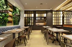 Some street lamp for the lightning decoration and the flooring style reflects the side roads. With bright lightning and wide space give comfortable and relax feeling suitable for young adult to hang out on this coffee shop.