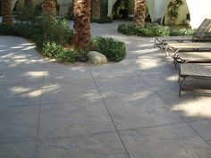 Stamped concrete for driveway...cut out in concrete for plantings