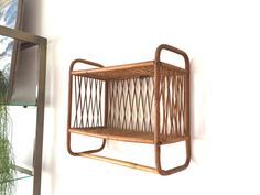 $46 Vintage Rattan & Wicker Shelf Rack Bohemian rustic 2-tier wall shelf with a towel bar. Made with split cane woven wicker and bent bamboo with a