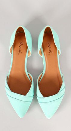mint pointed toe flats.