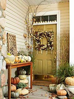 square wreaths for front door | Love the square wreath on this front door and the painted pumpkins on ...